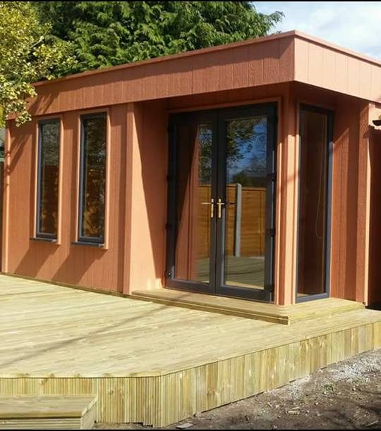 Garden office with LP Strongcore Cladding finished in country red with grey UPVC doors and windows.
