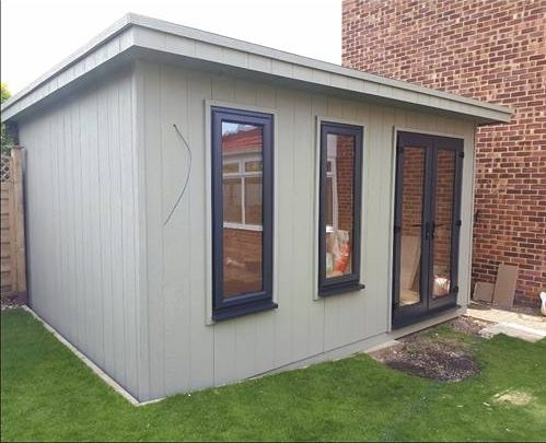Garden room with a pent roof with LP Strongcore Cladding and UPVC windows and twin door.